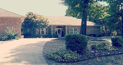 14 neffwood view from the street facing the house, lakefront home in bella vista for sale by burnett real estate team